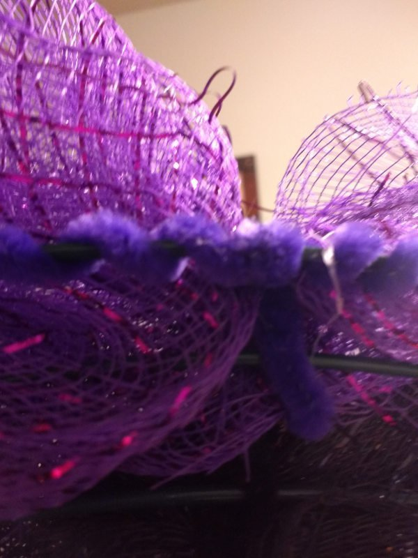 Deco Mesh Halloween Wreath Deco Mesh secure the ends of the pipe cleaners